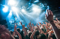 Crowd with raised nands during concert. At the concert club Royalty Free Stock Image