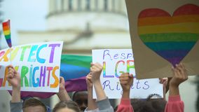 Crowd raising posters chanting to respect LGBT rights, support for gay marriage. Stock footage stock video
