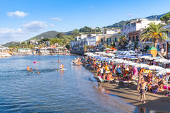 Crowd of resting tourists on Public beach, Ischia Royalty Free Stock Photography
