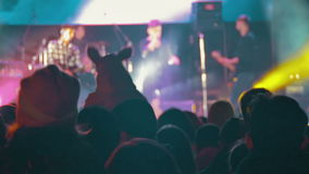 Crowd on Rock Concert. KAMENSKOE CITY, UKRAINE - OCTOBER 15, 2016, Rock concert at the Square Peter Kalnyshevsky. Crowd people dancing Rock concert, weighed stock footage