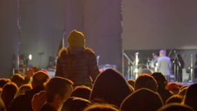 Crowd on Rock Concert. KAMENSKOE CITY, UKRAINE - OCTOBER 15, 2016, Rock concert at the Square Peter Kalnyshevsky. Crowd people dancing Rock concert, weighed stock video footage