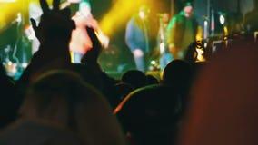 Crowd on Rock Concert. KAMENSKOE CITY, UKRAINE - OCTOBER 15, 2016, Rock concert at the Square Peter Kalnyshevsky. Crowd people dancing Rock concert, weighed stock video