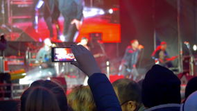 Crowd on Rock Concert. Crowd people dancing Rock concert, weighed, applauds, raises his hands up and photographed, filmed concert on the phones and smartphones stock footage