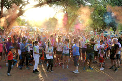 Crowd of runners throwing powder paint into air Stock Images