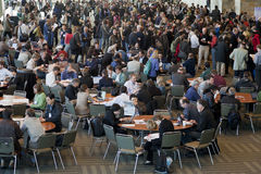 Crowd of scientists at coffee break stock images