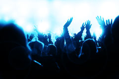 Crowd Cheering at the Concert. Happy crowd waving hands and cheering at the music concert Royalty Free Stock Image