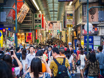 Crowd of Shoppers in Osaka Japan. Thousands of shoppers cram a covered shopping street in Osaka, Japan Stock Photo