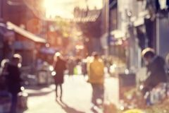 Crowd of shoppers walking and shopping on a high street. Crowd of blurred shoppers walking and shopping on a high street Royalty Free Stock Photo