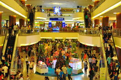 Crowd in shopping centre. This picture is taken at the Mid Valley Mega Mall, Malaysia. It is the biggest shopping mall in South East Asia. The picture shows Stock Photos