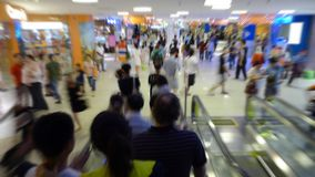 Crowd at Shopping Mall. People rushing by at a shopping mall during a sale Stock Photo