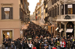 Crowd for shopping in Via Condotti in Rome. A large crowd of people invaded the streets of Rome during the Christmas shopping. Via Condotti is decorated and stock photos
