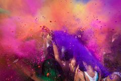 Crowd shot with colour. People throwing rainbow coloured powder in a crowd Royalty Free Stock Images