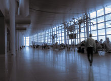 Crowd silhouette of people inside modern airport. Modern hall in airport passenger terminal with waiting people tinted blue Stock Photo