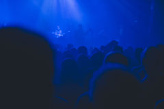 Crowd silhouette watching rock concert. Royalty Free Stock Photo
