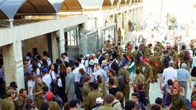 Crowd with soldiers entering to Western wall Stock Image