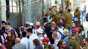 Crowd with soldiers entering to Western wall Royalty Free Stock Photo