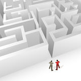 Crowd Source - Maze Strategy. Two people thinking about the maze infront of them. High detail Royalty Free Stock Photos