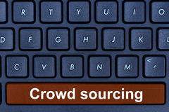 Crowd sourcing words on computer keyboard button Stock Photo