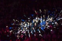 Crowd of spectators lit by a spotlight Royalty Free Stock Photo