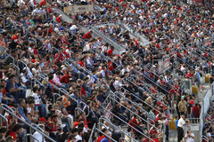 Crowd of spectators in the stands of the football field Stock Images