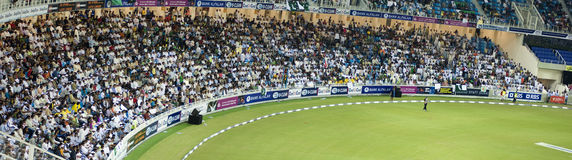Crowd in Stadium. Crowds cheering in the stadium during second T20 international between Pakistan & New zealand in Dubai Sports City stadium. Match Details Stock Photos