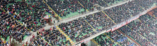 Crowd at the stadium. MILAN, OCTOBER 16: Supporters at Italian Championship soccer game, AC Milan - Chievo on October 16, 2010 in Milan Stock Image