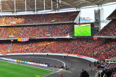 Crowd at stadium with big screen in the background Royalty Free Stock Photo
