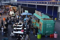 The crowd at the stage area at the Foodfestival. Amsterdam, the Netherlands - November 29, 2015: Visitors at the Hieper De Pieper and the Latin Food food truck Stock Photography