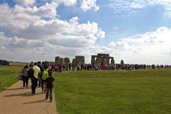 Crowd Stands in Front of the Rocks of Stonehenge. Amesbury, United Kingdom- September 2018, Crowd Stands in Front of the Rocks of Stonehenge On a Cloudy Summer royalty free stock photography