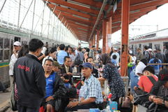 CROWD AT THE STATION. Jakarta, Indonesia, 28 February 2012 - Crowd passengers and traders at Depok Station, Indonesia Royalty Free Stock Photos