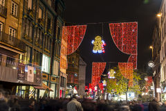 Crowd in Strasbourg (France) downtown with christmas illuminatio. Busy street in Strasbourg (France, Alsace) on a December night Stock Photos