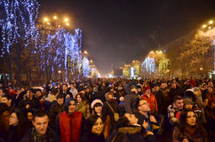 Crowd in the street 6. Thousands of people gathered in the New Year's Eve in Constitution Square(Piata Constitutiei) in Bucharest to view the fireworks, 01.01 Royalty Free Stock Images