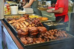 Crowd on the Street of SighisoaraGrilled meat specialties. Skewers, delicious. Grilled meat specialties in Sighisoara Medieval Festival Romania 26.7.2018 royalty free stock photography