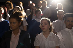 Crowd of Students. Crowd of teenage students in a lecture hall. They are looking towards the speaker, who can't be seen Royalty Free Stock Images