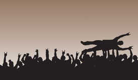 Crowd Surfing. Silhouette with crowd cheering in the background Stock Photography