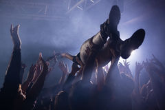 Crowd surfing at a concert. In nightclub Stock Images
