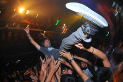 Crowd surfing at MacbethxCrooz tour in Bali, Indonesia royalty free stock photography