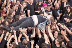 Crowd surfing at Wacken Festival Stock Photo