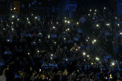 Crowd switch on lights on cell phones on tribunes during the Viktor Drobysh 50th year birthday concert at Barclay Center Royalty Free Stock Photos
