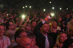 Crowd switch on lights on cell phones on tribunes during the Viktor Drobysh 50th year birthday concert at Barclay Center Stock Photo