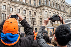Crowd taking pictures at Koninginnedag 2013. Koninginnedag or Queen's Day was a national holiday in the Kingdom of the Netherlands until 2013. Celebrated on 30 Royalty Free Stock Image