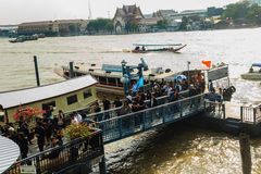 Crowd of Thai people passenger boats at Maharaj Pier to watch the royal procession transferring the body of the King Stock Photo