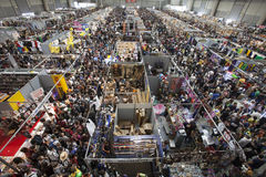 Crowd thousands people aerial view. Packed crowded fair. Romics 2015. Romics 2015. 4 October 2015, Rome, Italy. Thousands of people flock to the exhibition of royalty free stock photo