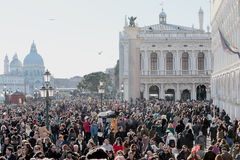 Crowd of tourist in St. Mark Square during the Carnival of Venice Stock Image