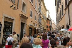 Crowd of tourists on the ancient street in Rome, Italy Stock Images
