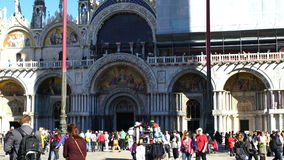 Crowd of tourists and birds at Basilica of Saint Mark stock video footage