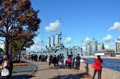 Crowd of tourists at the cruiser Aurora, Saint-Petersburg. Russian cruiser Aurora in Saint-Petersburg - legend of Revolution Royalty Free Stock Photography
