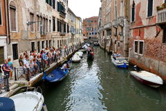 Crowd of tourists, floating motor boats and gondolas in Venice Royalty Free Stock Photography