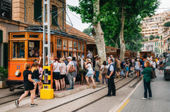 Crowd of tourists get on the old vintage tram, Mallorca Royalty Free Stock Images