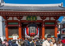 Crowd of tourists by giant red lantern in Kaminarimon Gate of Senso-ji Temple in Asakusa area. It is also known as Thunder Gate stock photos